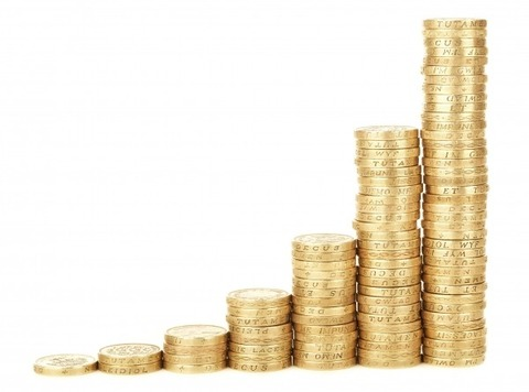 piles-of-coins-on-white-background