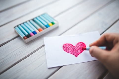 woman-drawing-red-heart-with-crayon