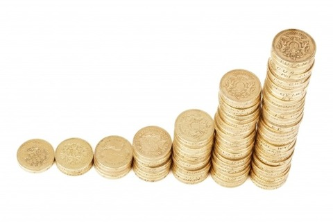 piles-of-coins-on-white-background-1