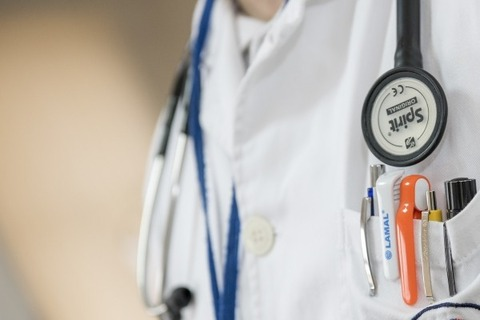 close-up-of-doctor-with-stethoscope-and-ballpens